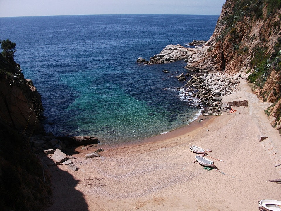 tossa de mar beach boat shore