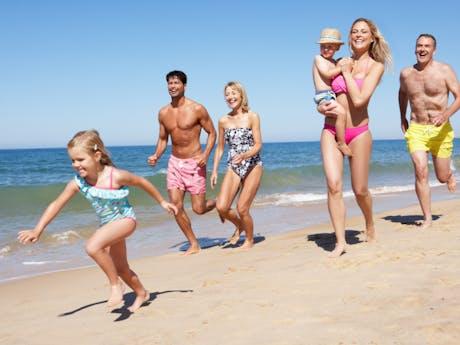 Grote gezinnen strand